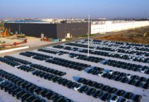 The aerial photo taken on Dec. 7, 2019 shows Model 3 sedans parked at the gigafactory of Tesla in the Lingang new area in Shanghai. Photo by People's Daily Online