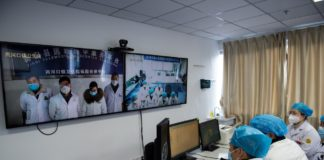 Experts of people's hospital of Zigui county, Yichang, Hubei province, hold a teleconsultation to discuss the situation of a suspected case of novel coronavirus pneumonia in a health center of Lianghekou town, Zigui, Feb.7, 2020. (Photo by Wang Jiaman/People's Daily Online)