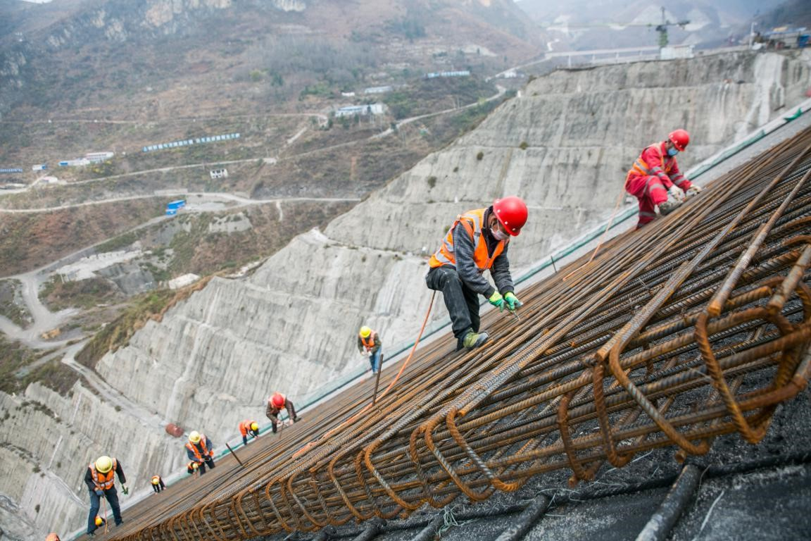 Constructors work at the site of Jiayan hydro-junction project in Pannuohe village, Tianba township, Qixingguan district of Bijie, southwest China's Guizhou province, Feb. 23. Photo by Su Bin, Xie Wenjuan, People's Daily